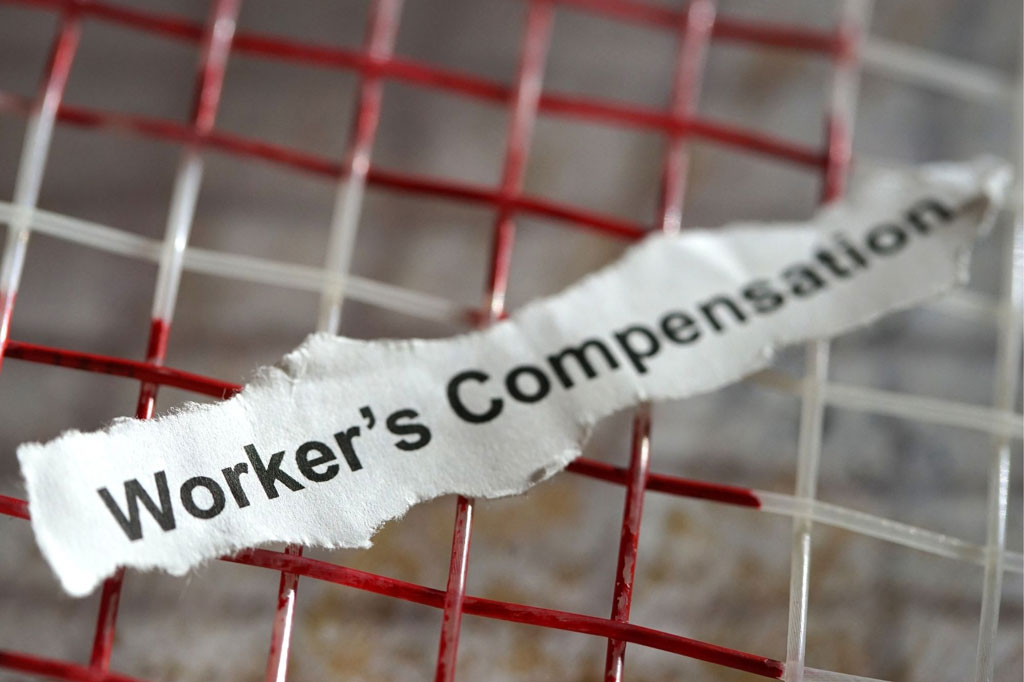 Worker's Compensation written on a piece of paper.